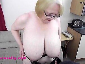 Big tits Granny soon has her young man hard